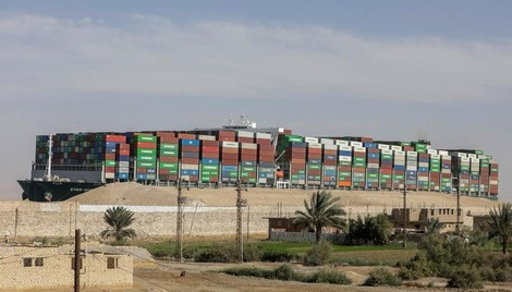 Dislodged ship held in Suez Canal as compensation talks continue - Reuters