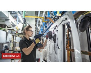 Car production hit by 'pingdemic' and global chip shortage - BBC