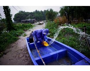 China's rain-swollen Yangtze river triggers unprecedented flood alert - Reuters