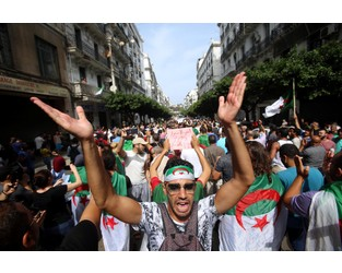 Algerians defiant in first protest since election call - Reuters