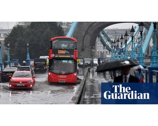 UK weather: flood warnings as heavy rain hits parts of England - The Guardian