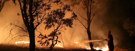 Companies feel the heat as bushfires choke Australia - Reuters