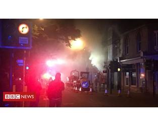 Homes evacuated due to shop fire - BBC News