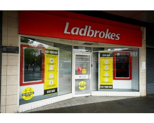 Ladbrokes owner suffers as shop closures eclipse online boom - Reuters