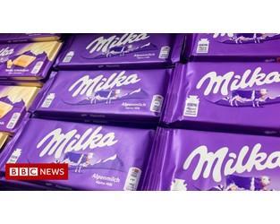 Mondelez threatens trademark battle over bar's lilac packaging - BBC