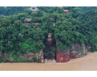 China evacuates 100,000 as floods threaten heritage site - Straits Times