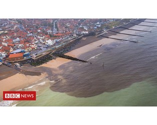 Sea turns brown after flooding at coastal town - BBC