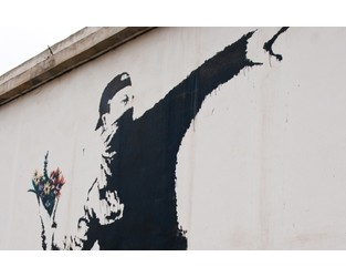 When art clashes with IP law: Banksy's 'Flower Thrower' - WIPR